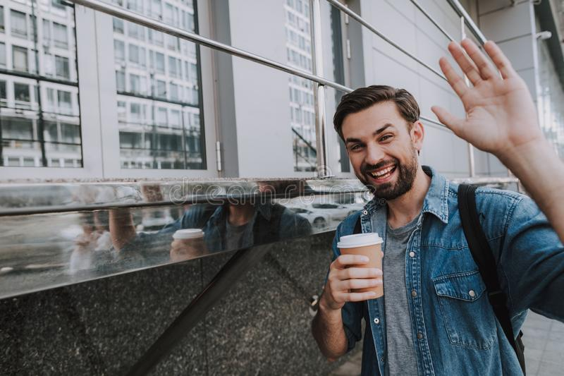 Happy man drinking cup of coffee outdoor stock photos