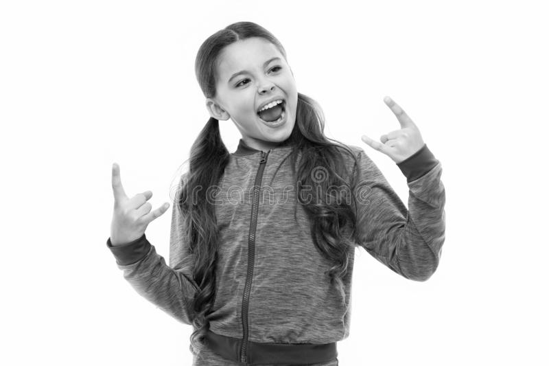I am going rock this party. Kid shouting with crazy expression doing rock symbol hands up. Music star. Girl enjoy sing royalty free stock photo