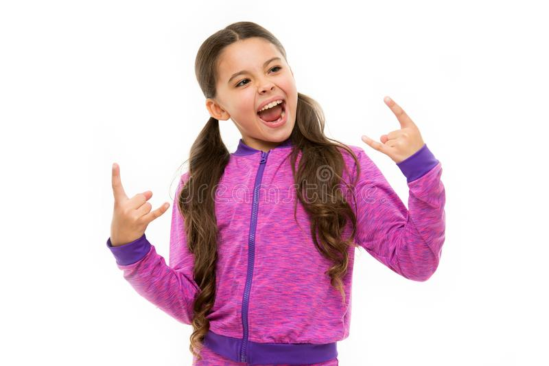 I am going rock this party. Kid shouting with crazy expression doing rock symbol hands up. Music star. Girl enjoy sing stock images