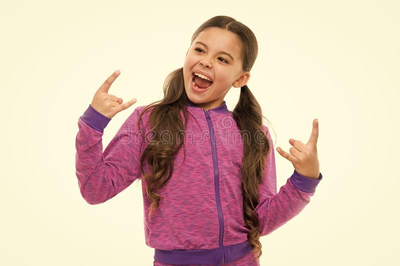 I am going rock this party. Kid shouting with crazy expression doing rock symbol hands up. Music star. Girl enjoy sing stock photos