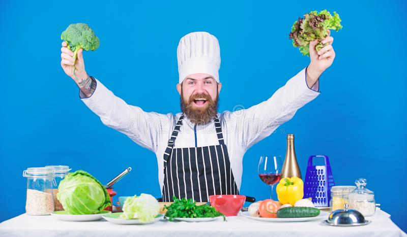 I got it. Dieting and organic food, vitamin. Bearded man cook in kitchen, culinary. Healthy food cooking. Chef man in royalty free stock photo