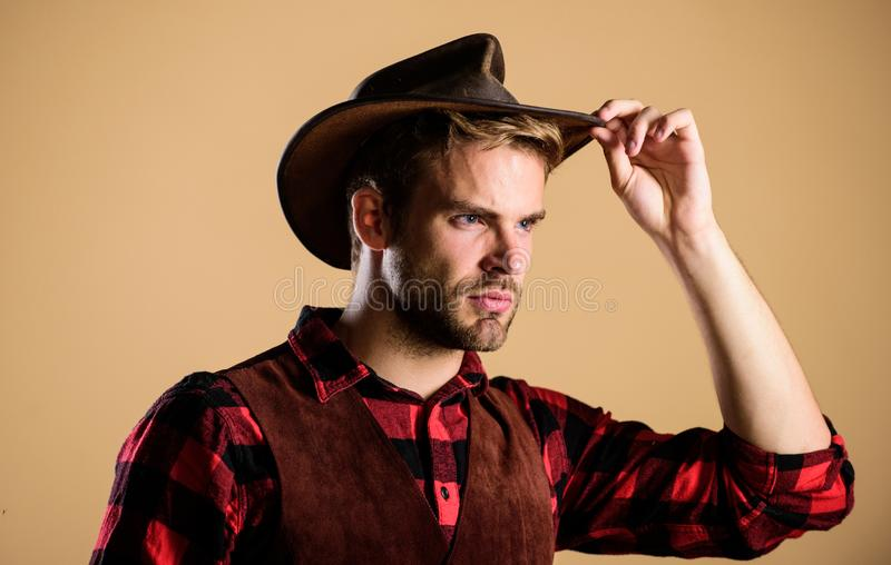 I got my eye on you. man checkered shirt on ranch. cowboy in country side. Western. Vintage style man. Wild West retro stock image