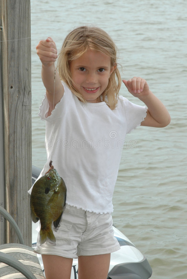 I got one! First Catch!. Girl catches first fish. Fishing girl! Gone fishing! Beautiful Young blonde model royalty free stock images
