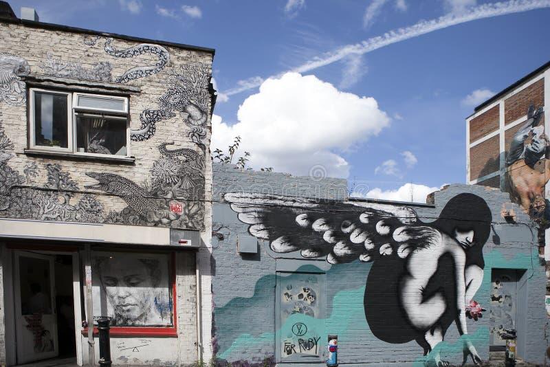 i graffiti urbani si avvicinano al vicolo Londra orientale del mattone fotografia stock libera da diritti