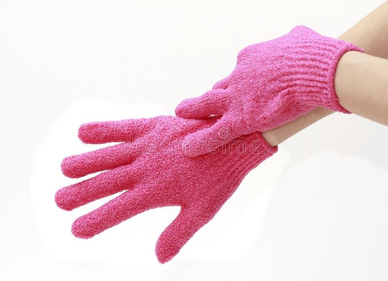 I guanti Exfoliating hanno isolato immagini stock