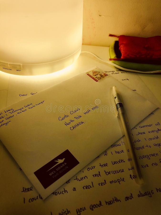 Envelop to Santa Claus with Romantic yellow light stock image