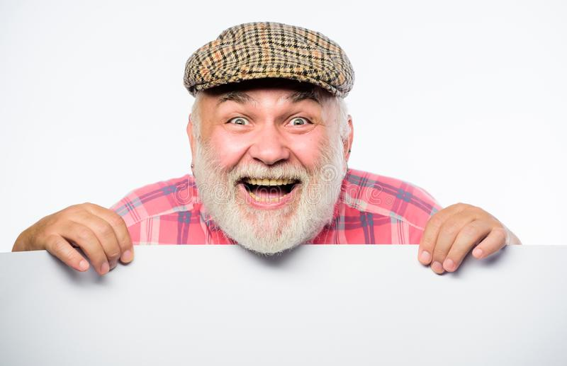 I am so happy. Copy space placate information. job search. Need help. Senior bearded man place announcement on banner royalty free stock image