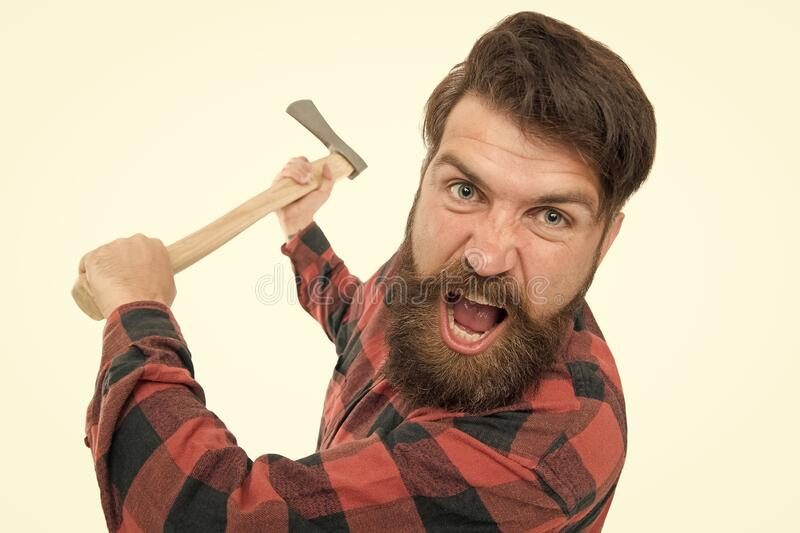 I hate it. Crazy man with axe isolated on white. Brutal lumberjack with crazy look. Bearded hipster in crazy mood. Threaten with axe. Crazy psycho stock photography