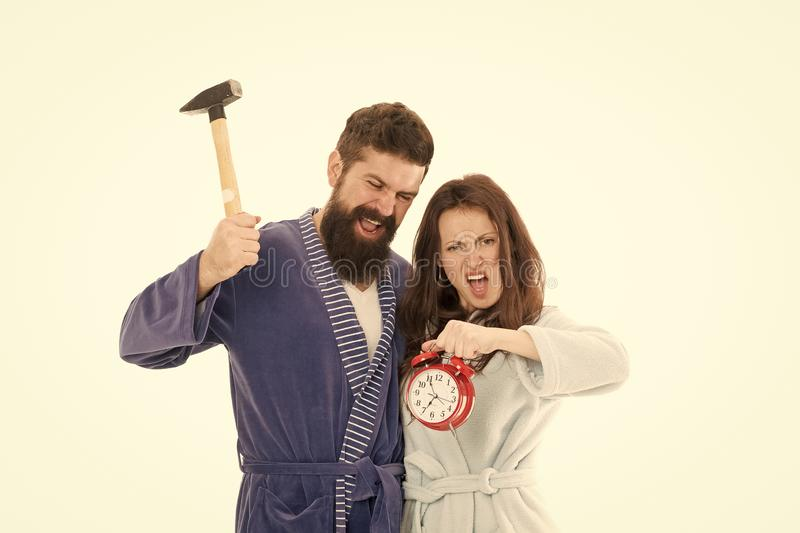 I hate monday. Couple morning awakening alarm clock. We should go to bed earlier. stressed bearded man and woman. Crush royalty free stock image