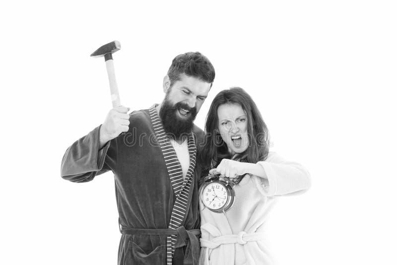 I hate monday. Couple morning awakening alarm clock. We should go to bed earlier. stressed bearded man and woman. Crush. I hate monday. Couple morning awakening royalty free stock photography