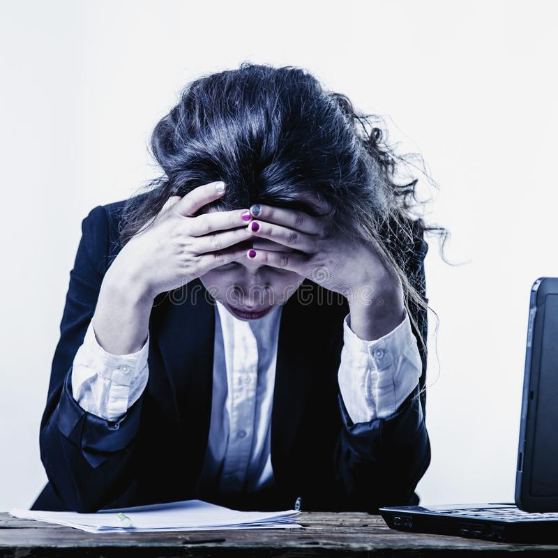 I hate my office work. Office hell. Woman going crazy with work. With documents. Low wages, overtime working hours, lack of career prospects concept. Body royalty free stock image