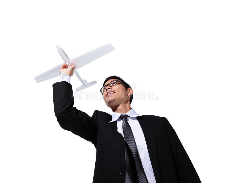 I have a dream. Businessman holding airplane isolated on white background, asian stock photography