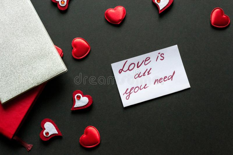 I have a dream. Love concept - valentine's day background. Red hearts and paper wit hand writing on black royalty free stock image