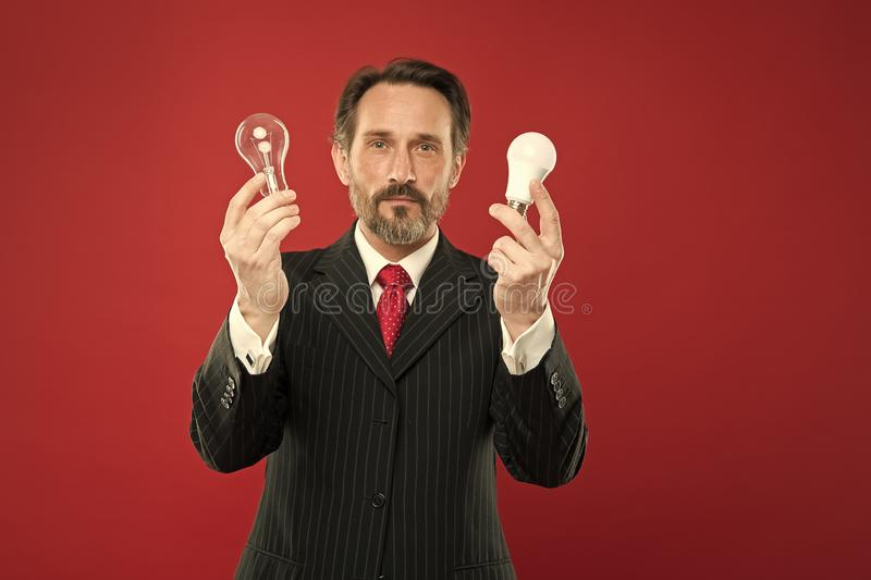 I have an idea. Power saving. Male in business outfit. Mature bearded man with lamp. Businessman in suit hold light bulb. Electricity and energy. Man with royalty free stock image