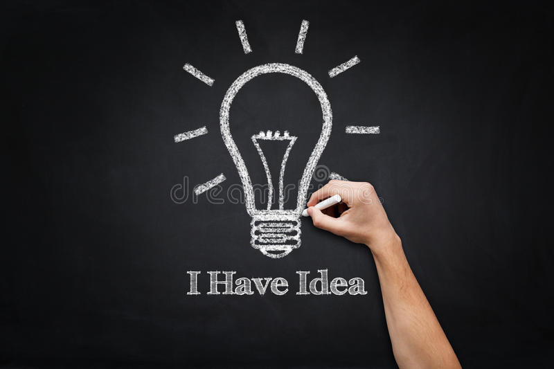 I Have Idea text drawing on blackboard with light bulb stock images
