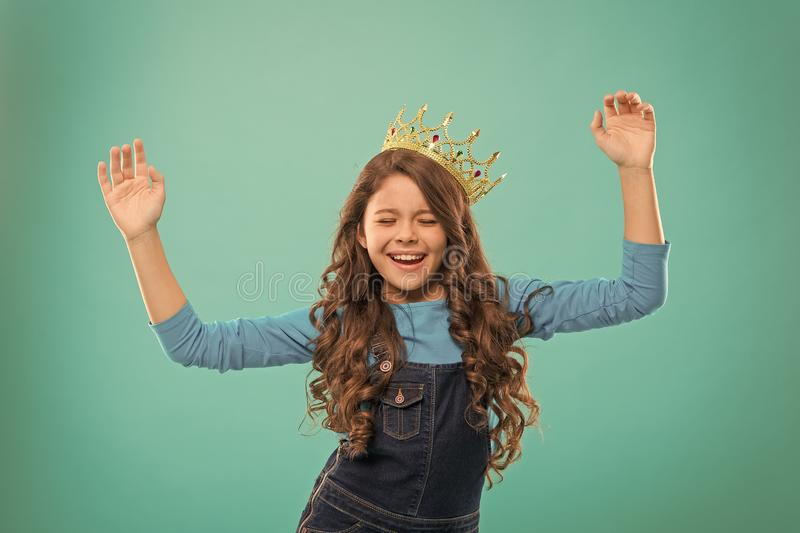 I am just the best. Kid wear golden crown symbol of princess. Girl cute baby wear crown. Become princess concept. Every stock images