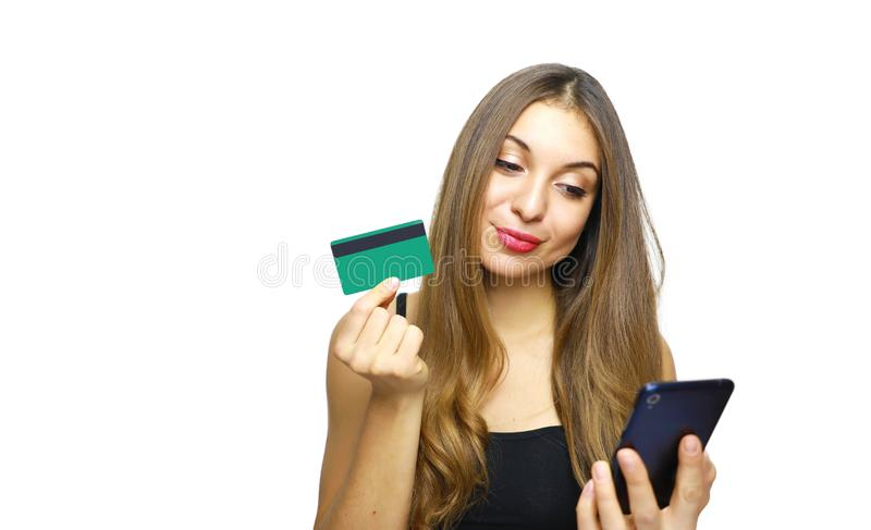 I know how to exhaust this card! Portrait of a smart young woman while using a credit card that is not her for doing shopping stock image