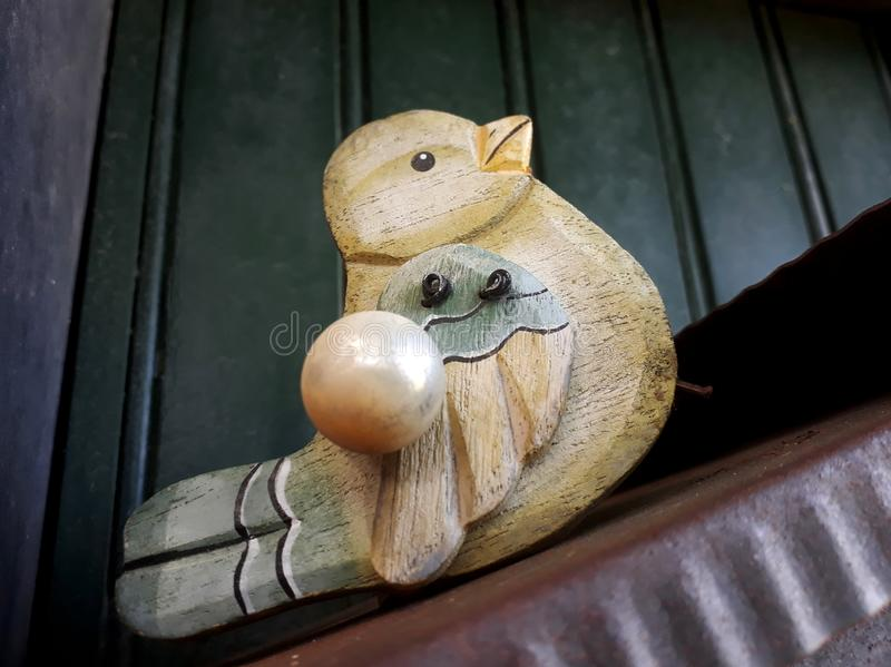I leave here. East Genoa, Italy. A wooden bird on a postal box, hand painted. Expression communicates: I leave here! Home decoration, simple but original royalty free stock photography
