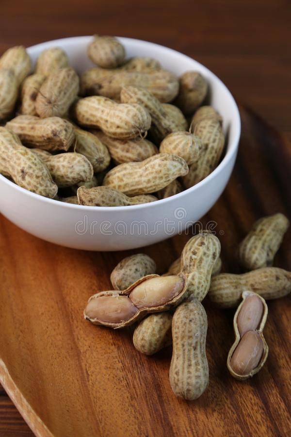 Boil peanuts in salted water. I let I put water and salt in a slightly bigger pan and boil and boil a straight peanut royalty free stock photos