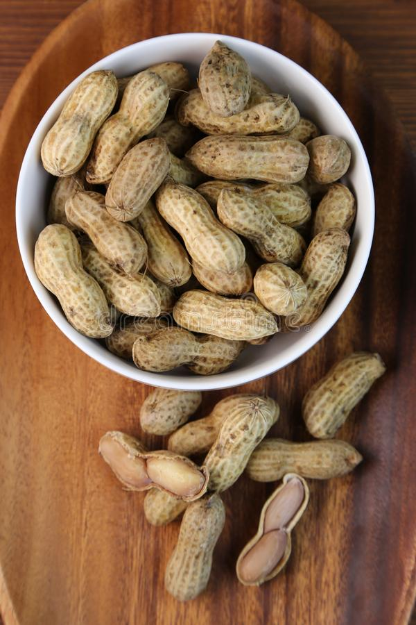 Boil peanuts in salted water. I let I put water and salt in a slightly bigger pan and boil and boil a straight peanut stock photography
