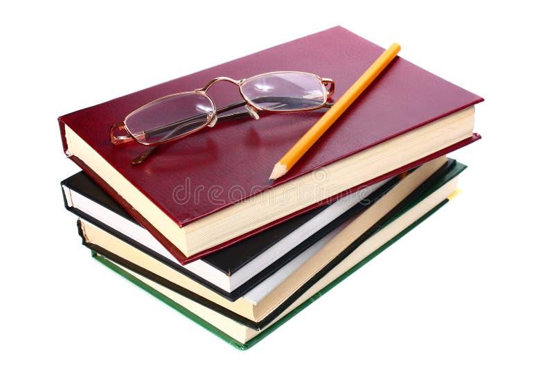 I libri è vetri e matita fotografia stock libera da diritti