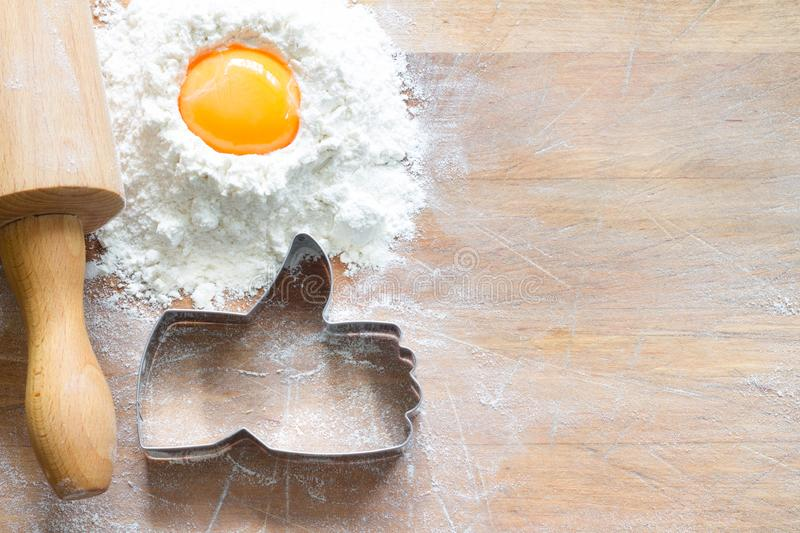 I like baking food concept with thumbs up cookie cutter on wooden background. Closeup royalty free stock photography