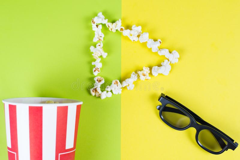 I like love adore watching new film concept. Top above high angle overhead close up view bright photo of play button with tasty. Popcorn and black 3d glasses stock photos