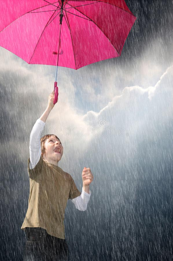 Free I Like The Rain, Boy With Pink Umbrella Stock Image - 125448971