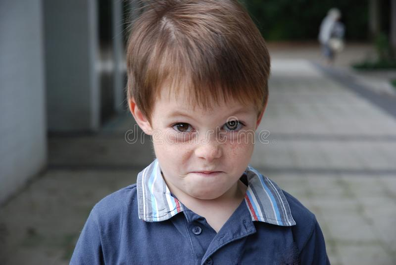I like to prank, mischievous looking boy royalty free stock image