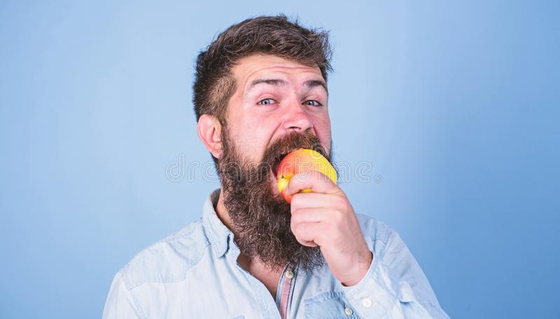 I love apples Man diet nutrition eats fruit. Healthy nutrition concept. Man handsome hipster with long beard eating stock photography