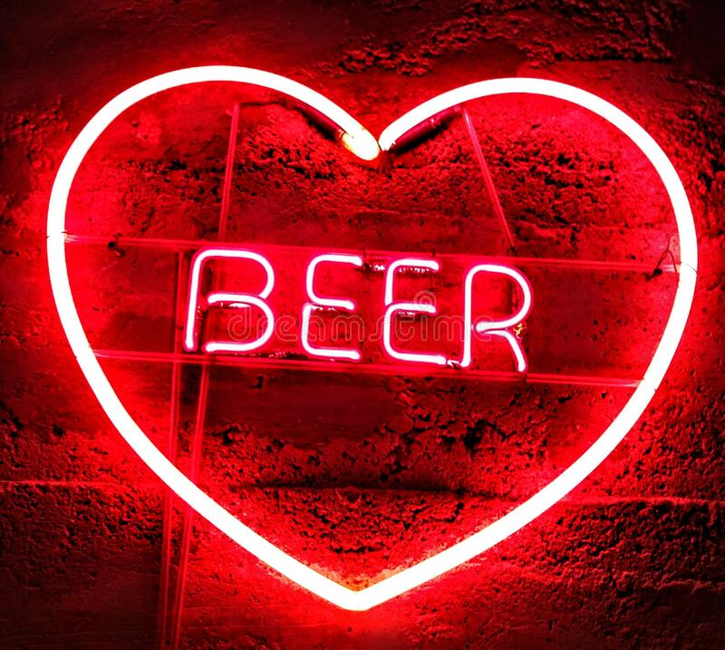 I love beer neon sign. The red heart has the word beer in the center stock images