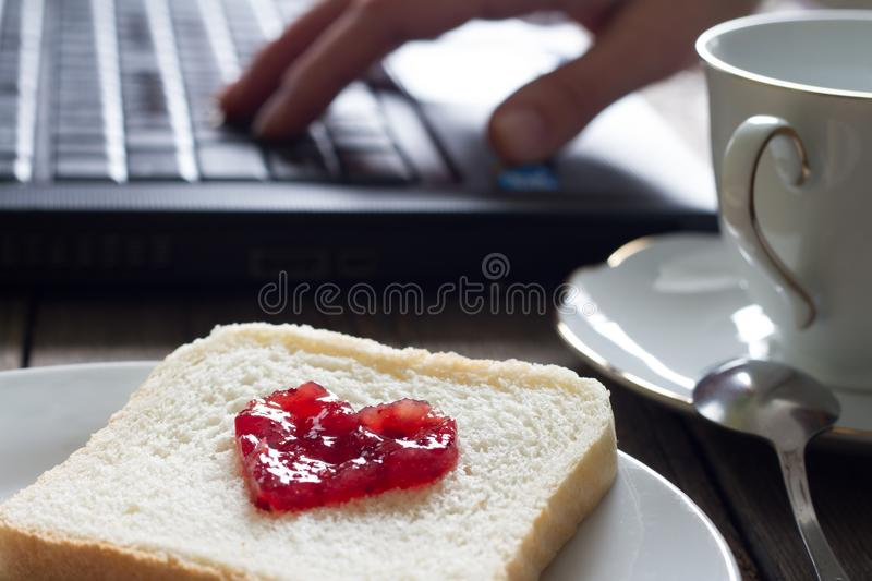 I love business workplace concept with laptop breakfast jam heart shape and coffee royalty free stock image