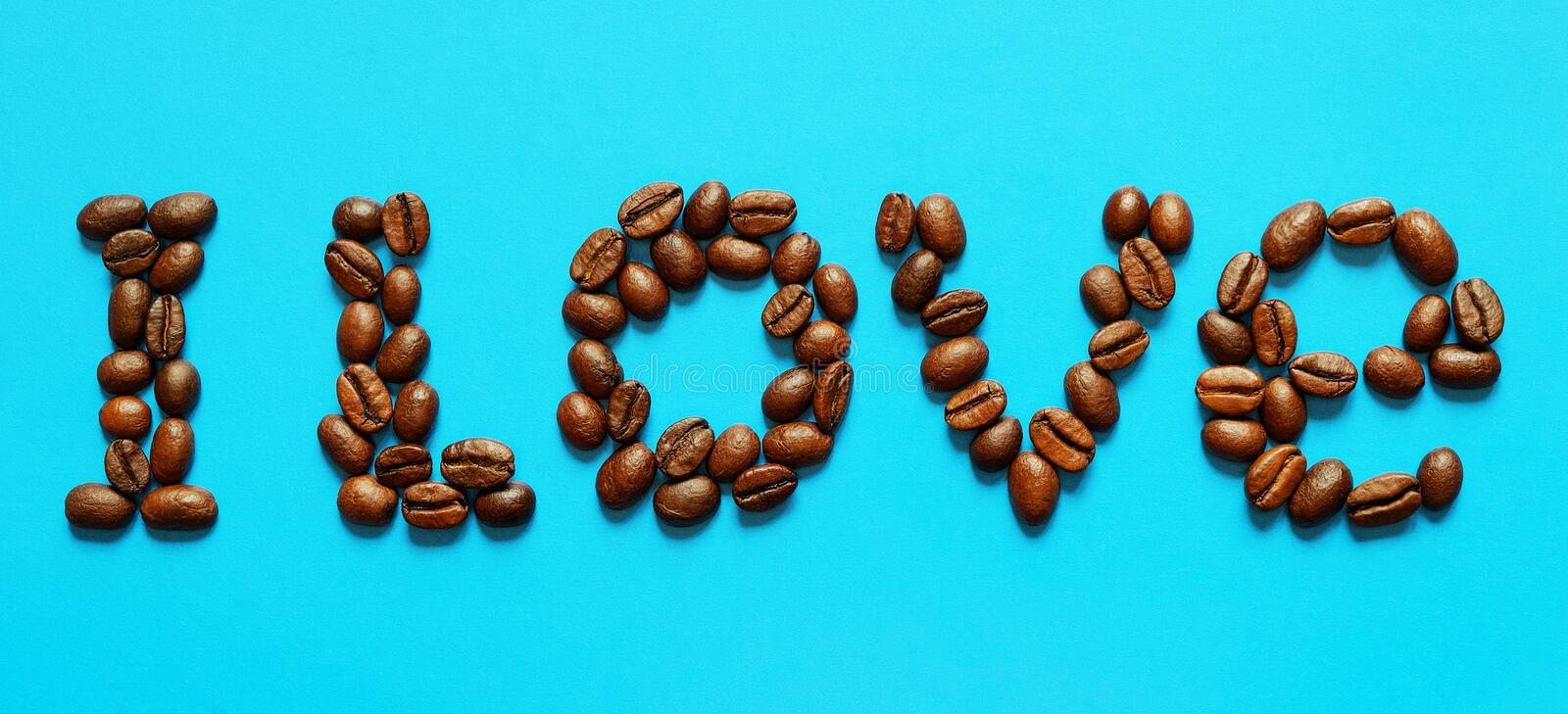 I love coffee word. Coffee word on a blue background stock photos