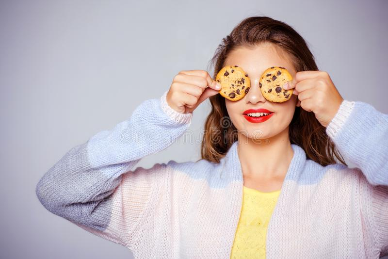 I love cookies. Bakery style chocolate chip cookie recipe. Pretty girl covering eyes with cookies. Cute girl having fun. With cookies. Bakery shop. Following a royalty free stock photos