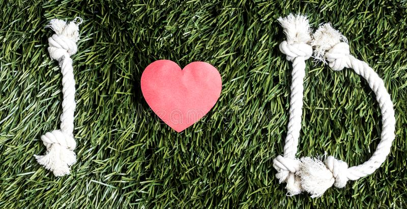I love D transcription made from ropes on grass background. I love D transcription made from ropes on grass background royalty free stock photos