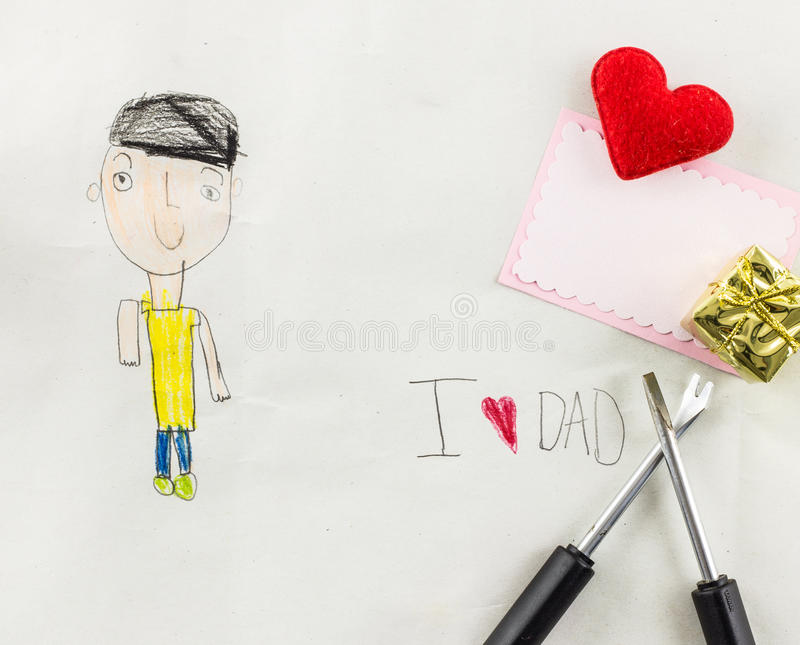 I love dad - kid write card. Five year kid draw father and write i love dad royalty free stock photography