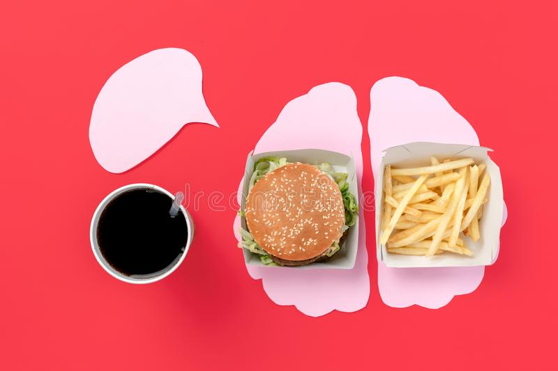 I love fast food. French fries in the form of brain isolated on red background. I love fast food. Burger and french fries in the form of brain isolated on red stock photography