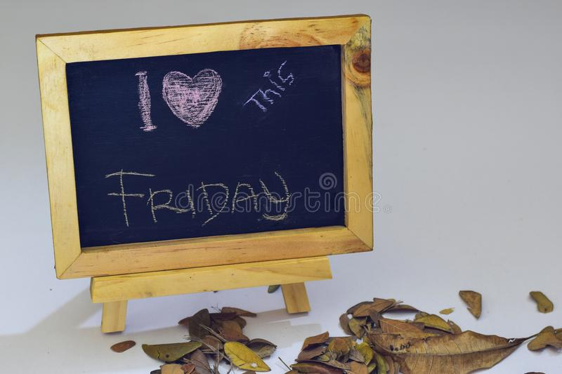 I love friday written on a chalkboard. Autumn seasonal flat lay photo on White background stock images