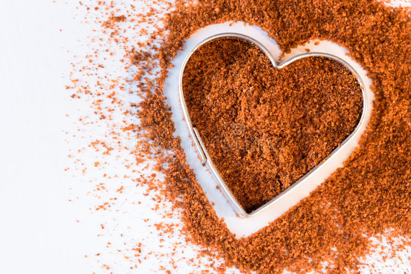 Ground Cayenne in a Heart Shape royalty free stock photography