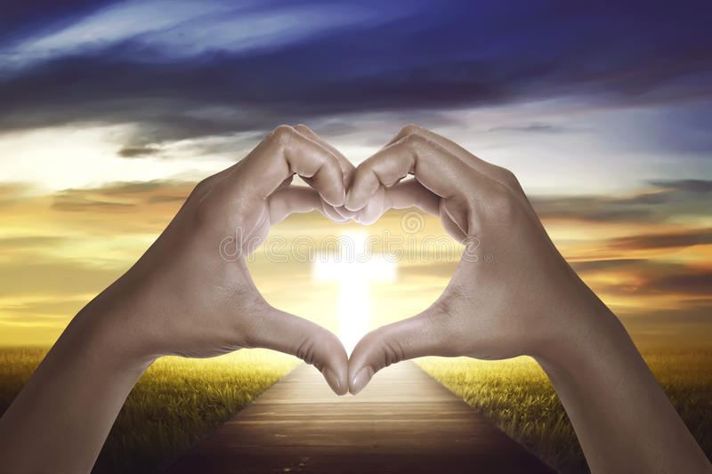 I Love Jesus. Hand shape love sign with christian cross on the sky royalty free stock images