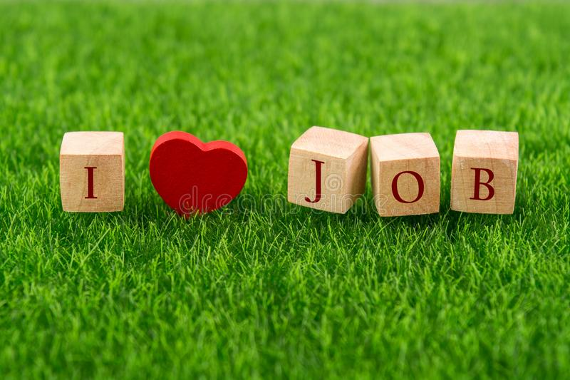 I love job in wooden cube royalty free stock image