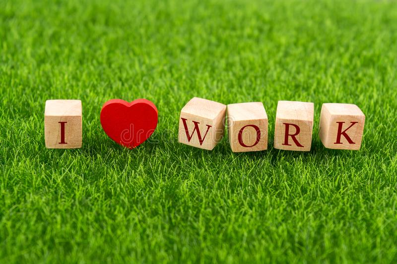 I love job in wooden cube royalty free stock photo