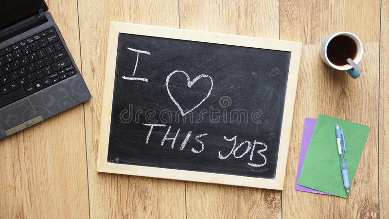I love this job. Written on a chalkboard at the office royalty free stock photos