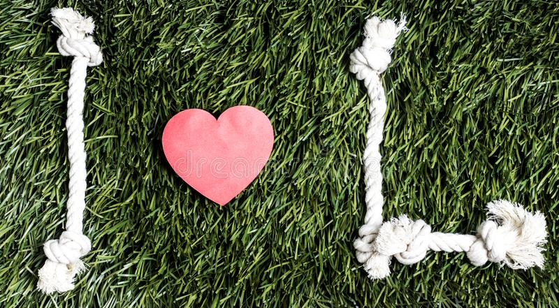 I love L transcription made from ropes on grass background. I love L transcription made from ropes on grass background stock images