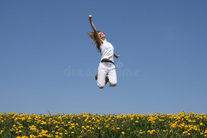 I love life!. Smiling girl in a happy jump stock photography