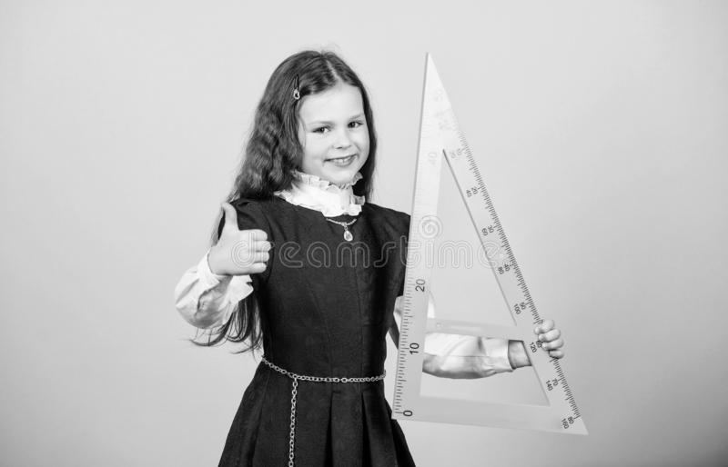 I love mathematics. Education and school concept. Smart and clever concept. Pupil cute girl with big ruler. School stock image