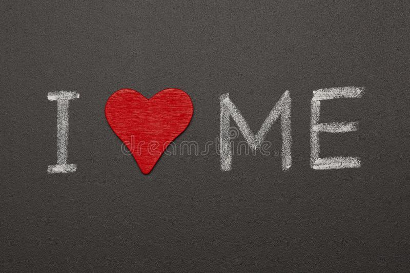 I Love Me Blackboard Concept. Self-loving concept made with red heart and handwritten text I Love Me with white chalk on blackboard royalty free stock photography