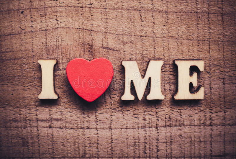 I Love Me. With rustic wooden background stock image
