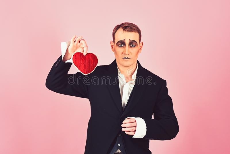 I love melancholy. Mime actor with love symbol. Mime man hold red heart for valentines day. Theatre actor pantomime royalty free stock image