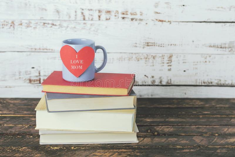 I love mom, books next to a cup of coffee royalty free stock photo